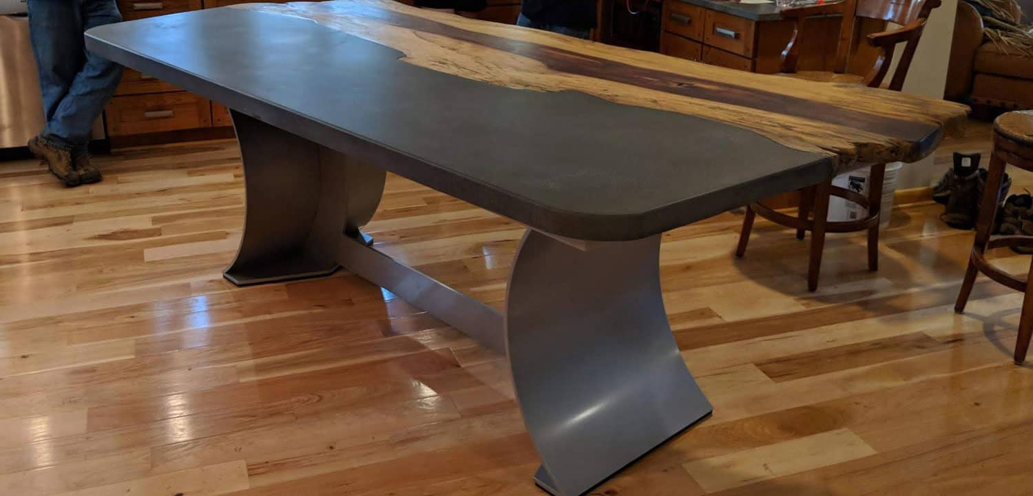 Live Edge Wood and Charcoal Colored Concrete Table with Aluminum Sculptural Base
